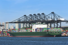 Cargo ship in container port Royalty Free Stock Photos