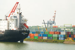 Cargo ship in the container terminal of the Port of Roterdam Stock Photography