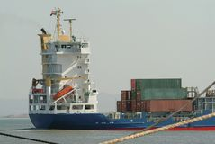 Cargo ship with containers. Sailing in sea stock images