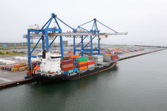 Cargo ship with containers in Copenhagen seaport Stock Image