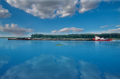 Cargo ship with containers on the Danube river, Europe. Goods transport. Stock Photo