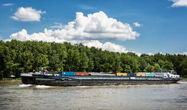 Cargo ship with containers on the Danube river, Slovakia Royalty Free Stock Image