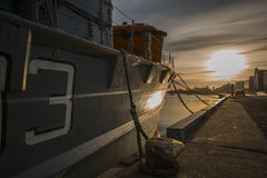 Cargo ship with containers moored in harbour Royalty Free Stock Images