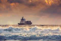 Cargo ship with containers in sunrise light Royalty Free Stock Photo