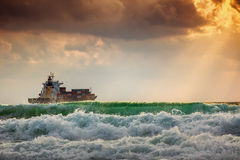 Cargo ship with containers in sunrise light Stock Photo