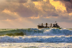 Cargo ship with containers in sunrise light Stock Images