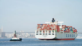 Cargo Ship COSCO PACIFIC departing the Port of Oakland Stock Photo