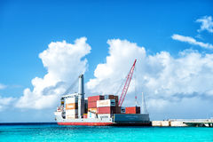 Cargo ship with crane and containers Royalty Free Stock Images