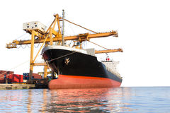 Cargo ship with crane in the harbor isolated on white background. With clipping path Stock Image