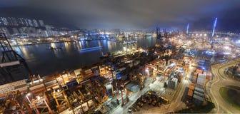 Cargo ship and crane at port reflect on sea bay, Royalty Free Stock Image