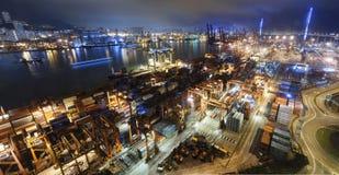 Cargo ship and crane at port reflect on sea bay, Stock Image