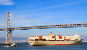 Cargo ship crossing San Francisco Bay bridge Royalty Free Stock Photography
