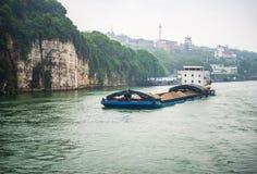 Cargo ship cruising on Yangtze river in rainy day Stock Photography