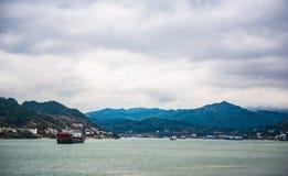 Cargo ship cruising on Yangtze river in rainy day Royalty Free Stock Images