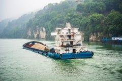 Cargo ship cruising on Yangtze river in rainy day Royalty Free Stock Photo