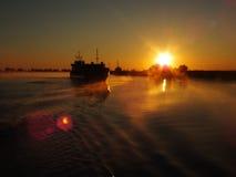 Cargo ship on Danube. Romania. Morning sun Stock Image