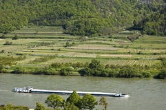 Cargo Ship in the Danube Valley Stock Image