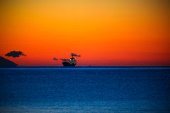 Cargo ship at dawn Stock Image