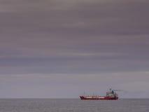Cargo ship departing Stock Photography