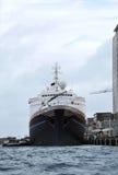 Cargo ship docked in port Stock Photo