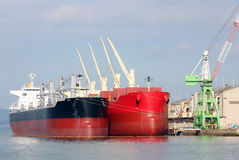 Cargo ship docked in the port. Cargo ship loaded with freight in port Royalty Free Stock Photo