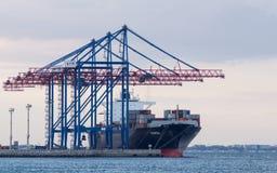 Cargo ship and Dockyard cranes. Odessa, Ukraine - September 23, 2016: Cargo ship and Dockyard cranes in Marine Trade Port. Heavy 279m length Container Ship MARCH Stock Images