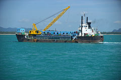 Cargo ship  drop container in the sea for artificial reef Royalty Free Stock Image