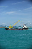 Cargo ship  drop container in the sea for artificial reef Royalty Free Stock Images