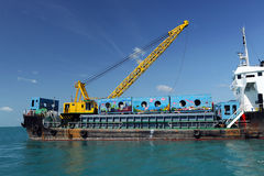 Cargo ship  drop container in the sea for artificial reef Stock Photography
