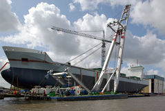 Cargo ship on dry dock. Newly built vessel before launched at Foxhol, The Netherlands Stock Photos
