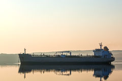 Cargo ship in the early morning light Stock Photo