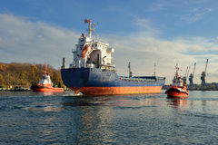 Cargo ship entering Gdansk harbour Stock Photography