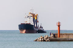 Cargo ship entering harbor Royalty Free Stock Photos
