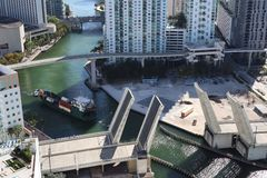 Cargo ship entering the Miami River in Downtown Miami. A divorced bridge. Passage of a cargo ship under the bridge. Taken from the royalty free stock photos