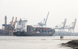 Cargo ship entering port in Swinoujscie, Poland Stock Photos