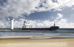 Cargo ship entering port. Royalty Free Stock Images
