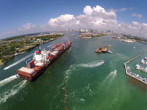 Cargo ship enters port aerial view Royalty Free Stock Image