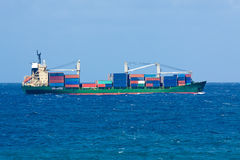 Cargo ship filled with containers on open sea Royalty Free Stock Images