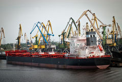 Cargo ship in Finnish harbor. More harbour cranes and Container Ship Stock Image