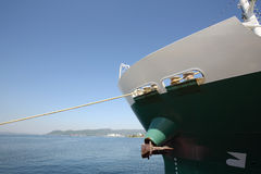 Cargo ship. Front view of cargo ship docked in the port Royalty Free Stock Image