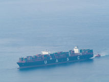 Cargo Ship full of container with tugboat viewed from above Royalty Free Stock Photography