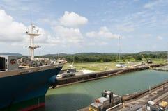 Cargo ship in the Gatun Locks, Panama stock images