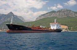 Cargo ship. Giant cargo ship in front of Toros Mountain, Antalya royalty free stock photo