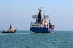 Cargo ship goes to sea Royalty Free Stock Photos