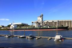 Cargo ship & grain elevator. Stock Images