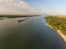 Cargo ship in green river water. Stock Image