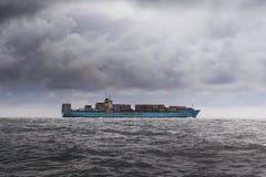 Cargo ship in grey waters Stock Photos
