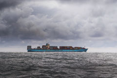 Cargo ship in grey waters Stock Photos