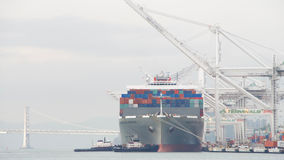 Cargo Ship HAMBURG BRIDGE departing the Port of Oakland. Oakland, CA - December 13, 2016: Cargo Ship HAMBURG BRIDGE preparing to depart from the Port of Oakland Royalty Free Stock Photos