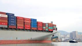 Cargo Ship HAMBURG BRIDGE departing the Port of Oakland. Oakland, CA - December 13, 2016: Tugboat PATRICIA ANN at the bow of cargo ship HAMBURG BRIDGE maneuver Stock Photo